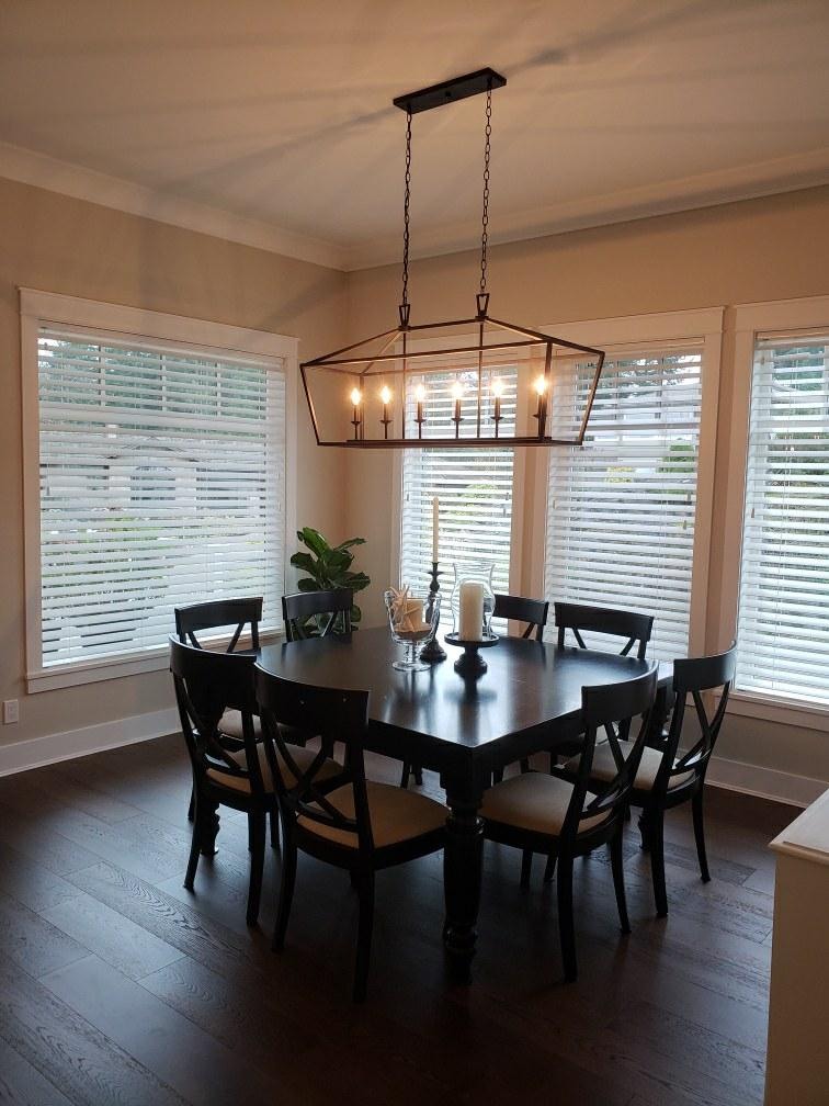 Budget Blinds of Delta, South Surrey and White Rock in Delta: These faux woods just add the classic touch to these windows while letting the clients furniture do the talking. Function and style in one and help block direct sunlight from the nook in a classic white colour.