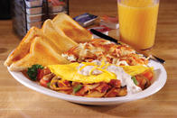 Farmers Omelet - Onions, peppers, mushrooms and tomatoes sautéed with crispy bacon folded inside an omelet with cheddar cheese topped with creamy sausage gravy. Served with hash browns or fresh fruit and choice of toast, biscuit or two pancakes.
