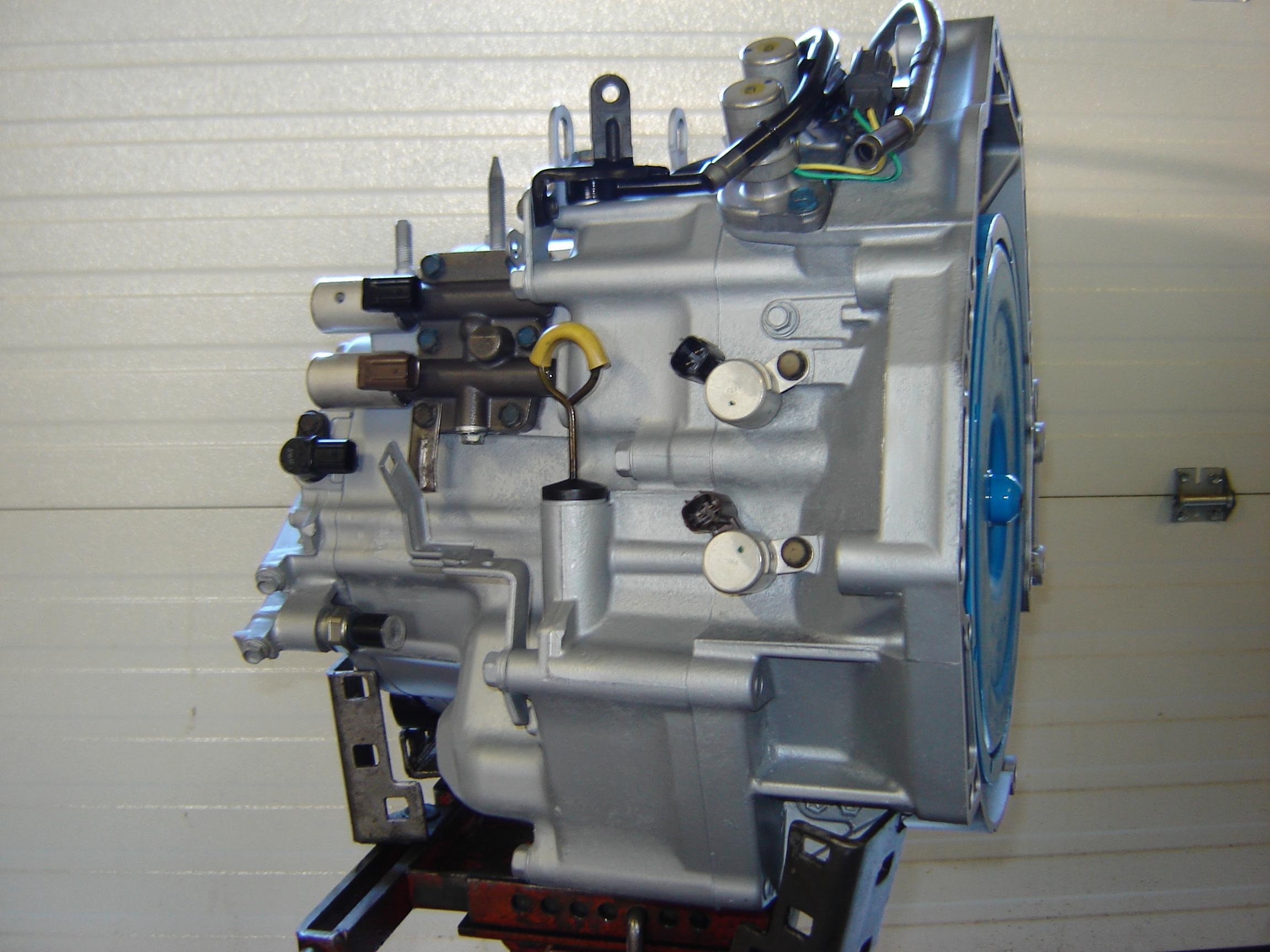 This is how a typical rebuilt Honda transaxle will look moments before installation, complete with a remanufactured torque converter and new electronics.
