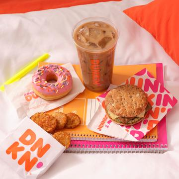 Dunkin' Oatmilk Iced Latte, Power Breakfast Sandwich, Strawberry Frosted Donut and Hash Browns