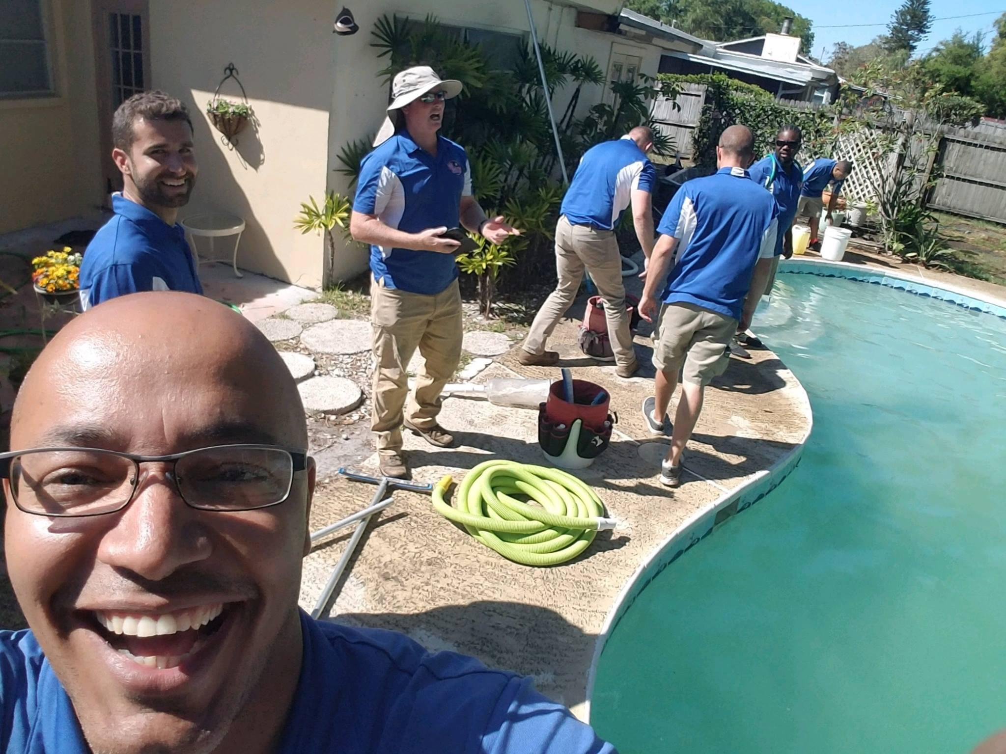 Pool Troopers Technicians Servicing a Pool