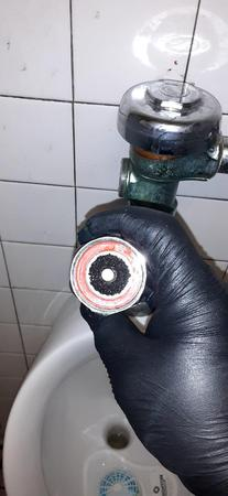 urinal repair in Miami