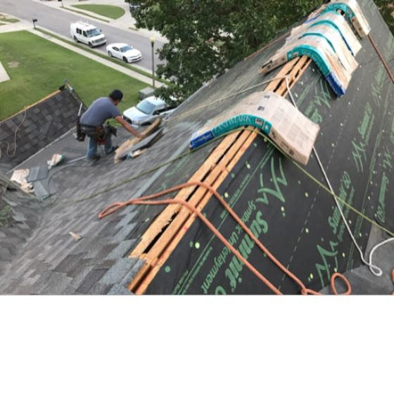 The team at Capstone Roofing working to replace a roof in Hoover, Alabama. This home is located in the Lake Crest subdivision and the roof was damaged by hail. Our team of professionals are replacing the roof, gutters, and completing some interior repairs. Call Capstone Roofing for a free roof inspection today!