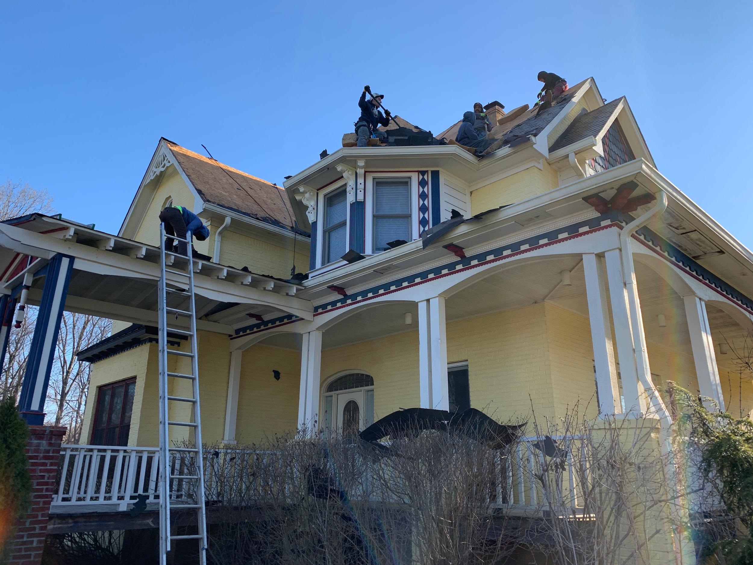 Residential roofers removing the shingles from a client's house.