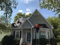 Roofing specialists in Wilmington, NC doing amazing metal roofing installation job.