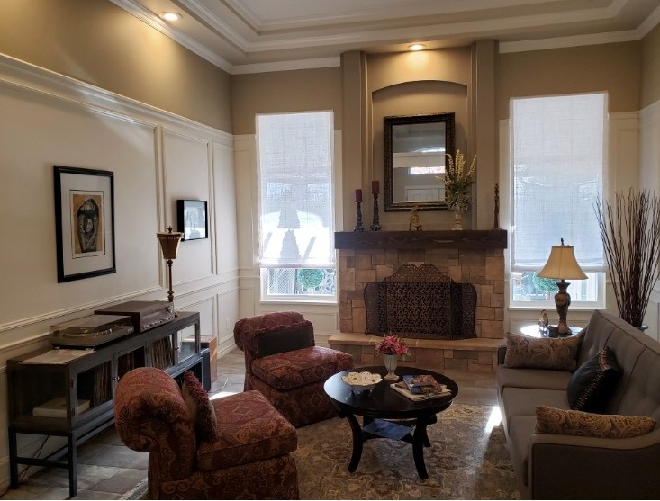 Budget Blinds of Delta, South Surrey and White Rock in Delta: Roman Shades in White Rock. These classic linen roman shades finish the style of this room perfectly while offering a touch of elegance without taking away from the statement fireplace wall
