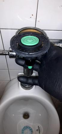 Miami 24/7 Plumbing repairing an urinal repair in Miami