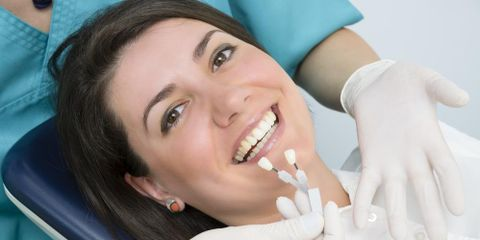 How Dental Implants Stay Put & Answers to Other Frequently Asked Questions