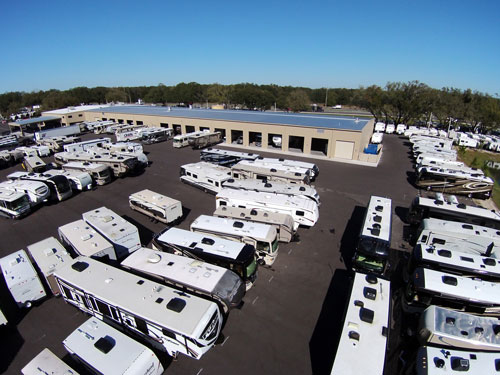 A shot of the service bays at our General RV Tampa location along with some of our new inventory.