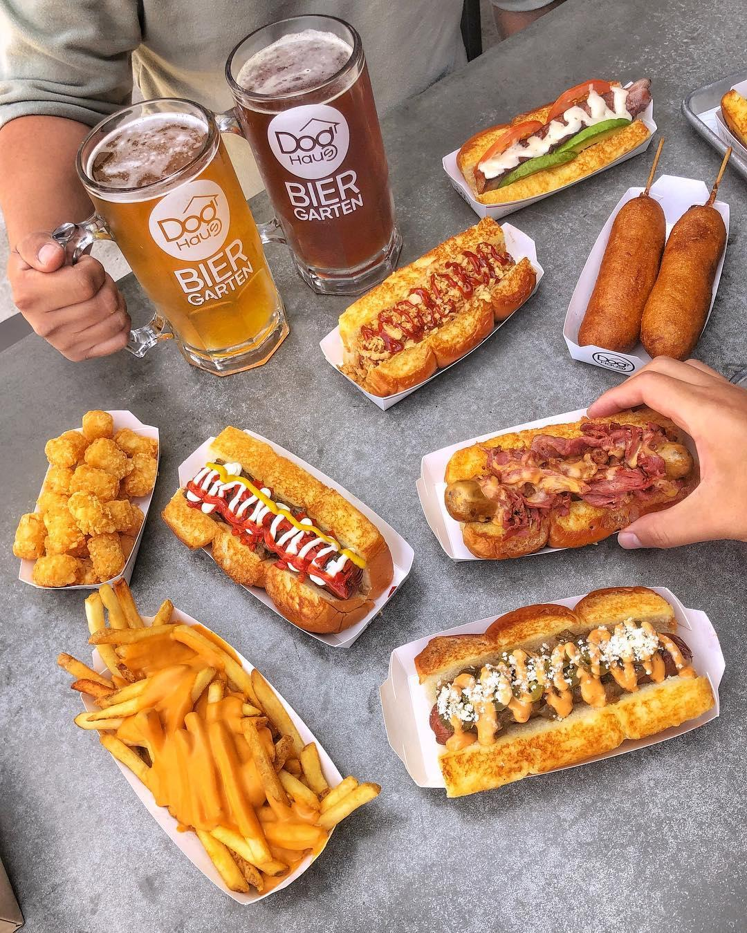 Nothing goes better with one of Dog Haus' Haus Dogs than some epic sides and cold craft beer.