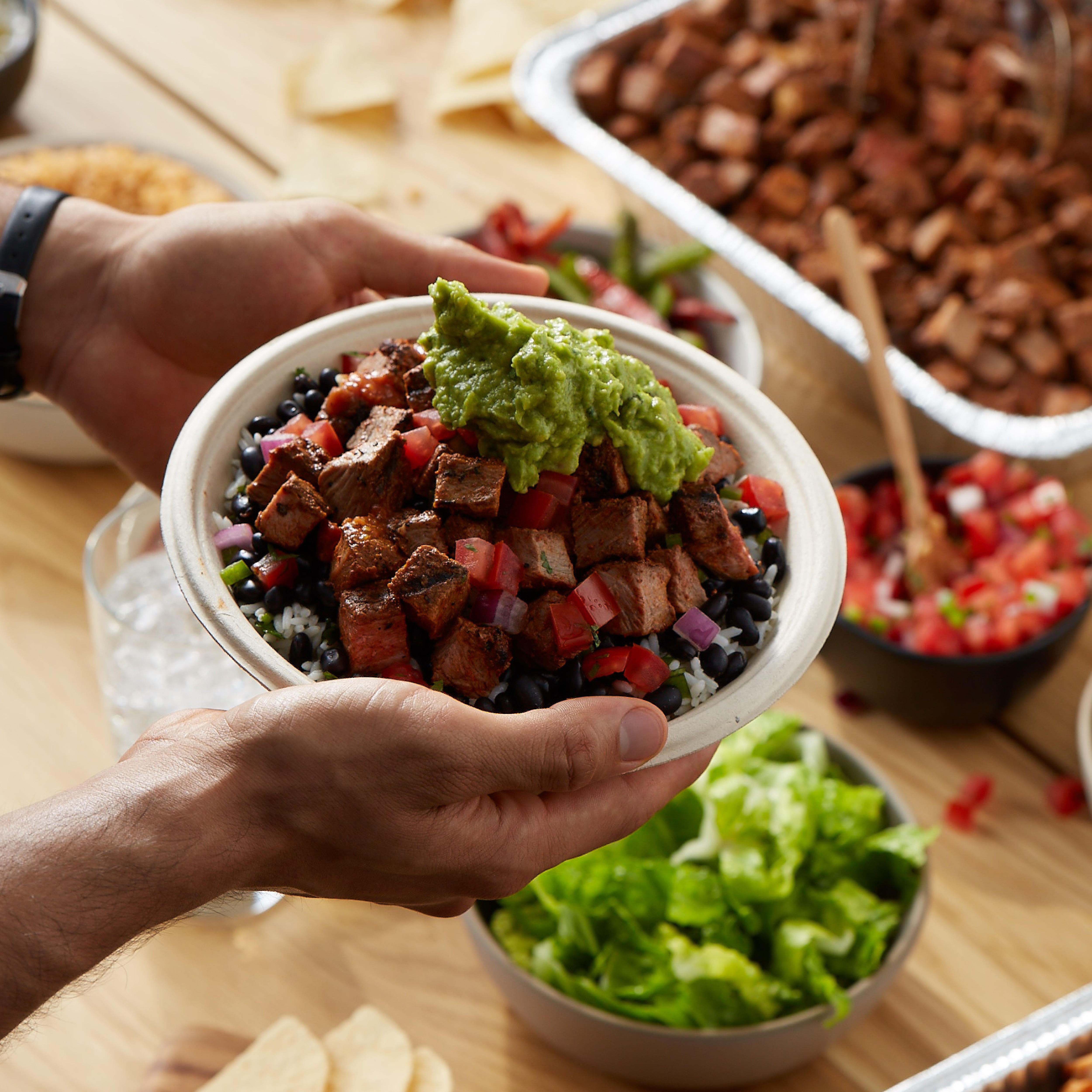 Top any of your flavorful creations, like a steak burrito bowl, with fresh, hand-smashed guacamole at no charge!