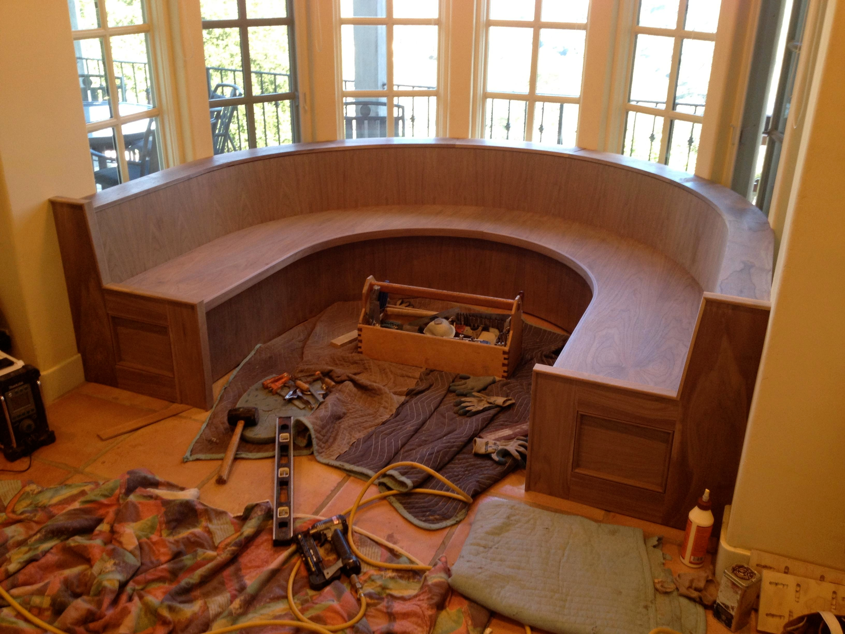 Banquette before bleaching, sealing and custom table.
